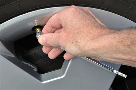 Checking The Air Pressure Of A Tire Royalty Free Stock