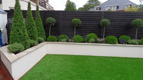 green garden fence rendered wall but without capping note colour of wooden 1374