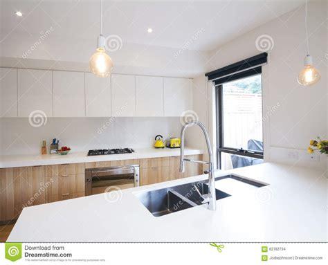 sunken sink kitchen modern kitchen with pendant lighting and sunken sink stock 2613