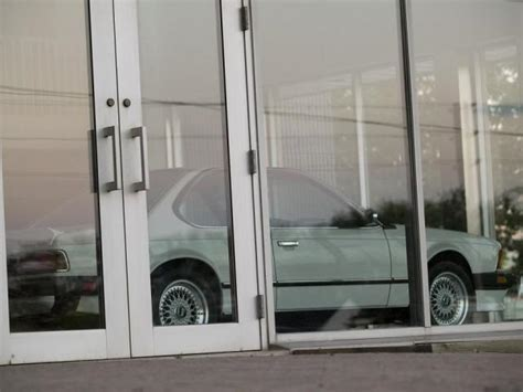 bmw dealership abandoned   sits frozen  time