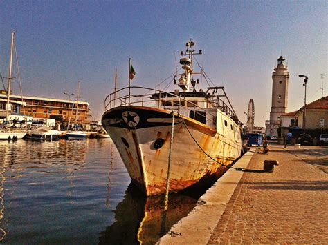 Port Boat by Fishing Boat Docked In The Port Canal Visit Rimini