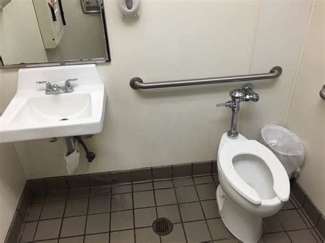 Family Bathroom With Toilet, Sink, Changing Table, And