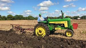 John Deere 730 Plowing A Field