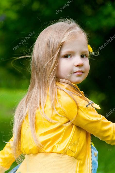 Adorable Little Girl With Long Hair In Yellow Jacket