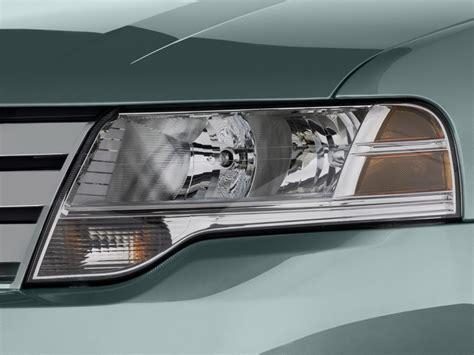 image 2008 ford taurus 4 door sedan sel fwd headlight size