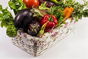Fresh vegetables in basket on white | Stock Photo | Colourbox