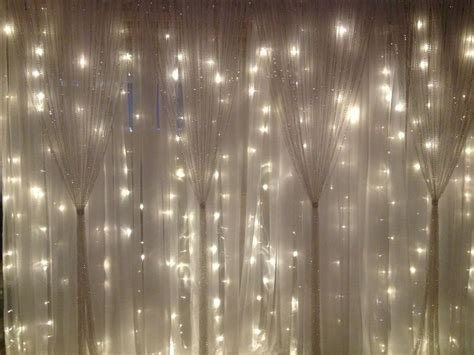White Fabric, String Lights, Sparkle Curtains