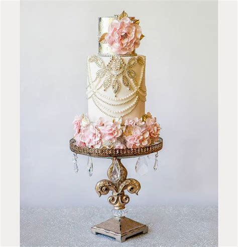modern cake stand gold and pink wedding cake by cakes