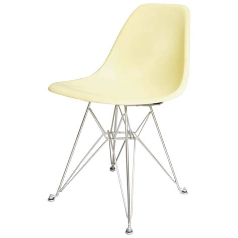 eames side shell chair in lemon yellow on eiffeltower base