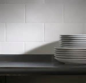how to apply backsplash in kitchen subway tile bob vila