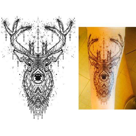tattoo cerf etoile kolawi