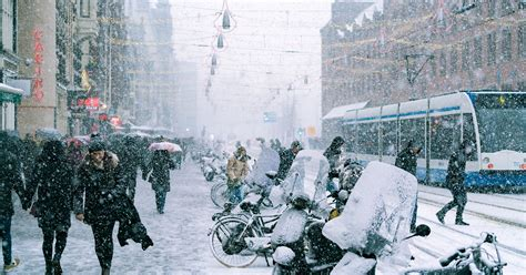 Capturing A Snowy Day In Amsterdam