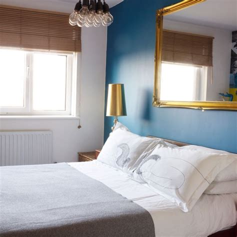 Neutral bedroom with blue feature wall   1970s inspired flat   housetohome.co.uk
