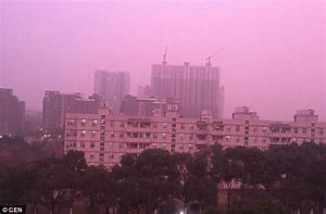 Nanjing residents shocked as heavy smog turns magenta in ...