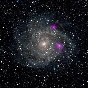 NASA's NuSTAR peeps black holes 7 million light years away ...