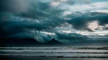 Ocean Surf Storm Clouds Rocks Background 4k