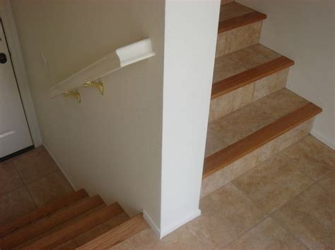 25 best ideas about tile on stairs on custom carpet my custom and hardwood stairs