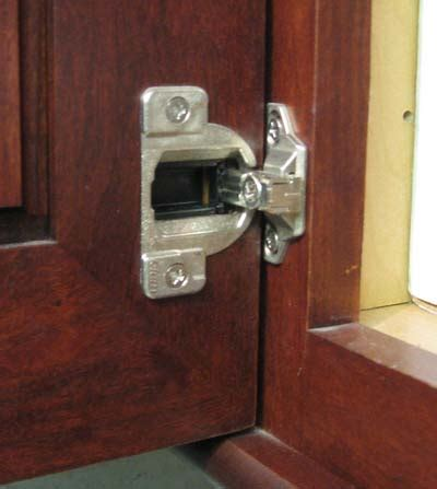fixing hinges on kitchen cabinets wood mode cabinet hinge and adjustment better kitchens 8943