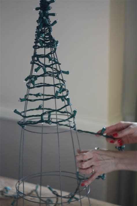 how to do christmas lights on trees 17 apart diy tomato cage christmas tree lights