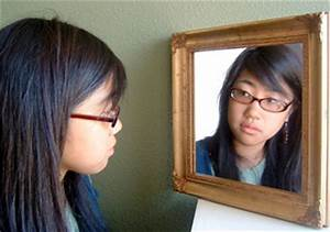 Insecure Person Looking In Mirror