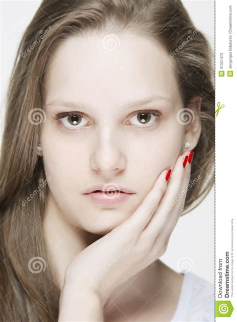 portrait  young natural  woman touching  face   hand stock  image