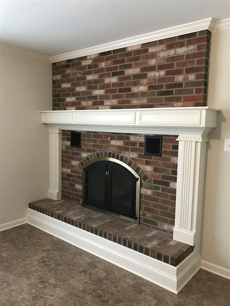 updated brick fireplace   surround trim
