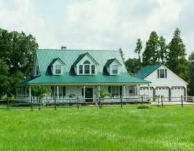 smart placement farmhouse plan with wrap around porch ideas dormered farmhouse with green metal roof and wrap around