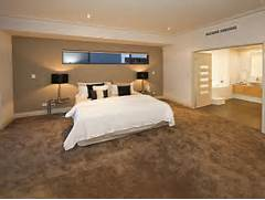 Bedroom Carpeting Ideas of Modern Bedroom Design Idea With Carpet French Doors Using Brown Colours