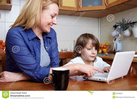 Mother Son Sits Kitchen Use Laptop Stock Image