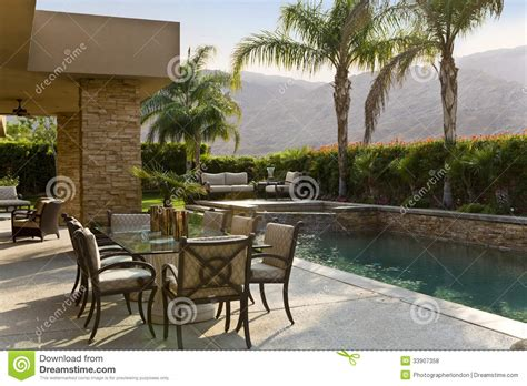 outdoor table by swimming pool royalty free stock photos