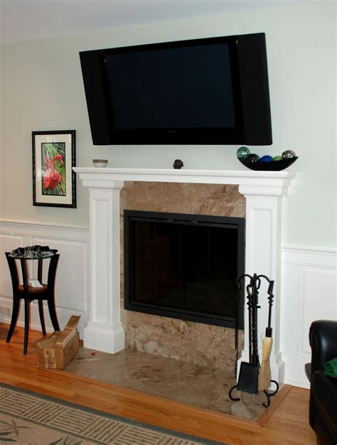 marble fireplace surround and wooden white mantel with lucite table and zebra fireplace surrounds with marble panel and