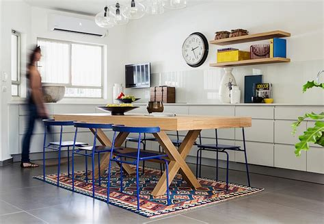 chic light wood kitchen table and blue dining chairs