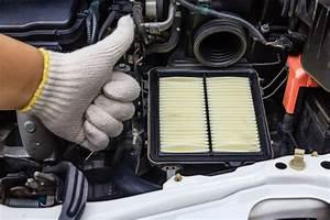 Auto Mechanic Changing Air Filter B