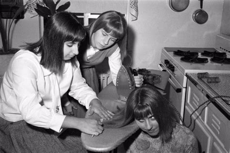 Teenage Girls Iron Their Hair Before A Night Out In New