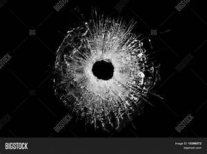 Bullet Hole In Glass Isolated on black Stock Photo & Stock ...