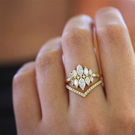 unusual engagement ring set with marquise diamonds artemer