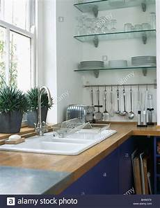 Double White Sink Below Window In Modern Kitchen With