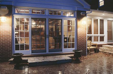 great room addition carefully modernizes  colonial brick