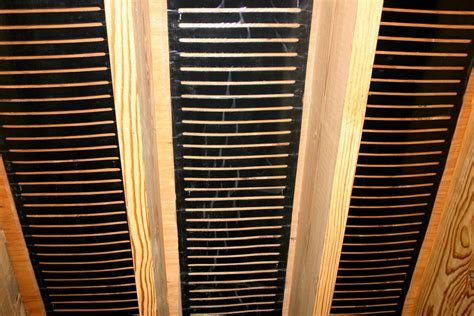 Stapling Underfloor Heating Between Floor Joists to Heat a