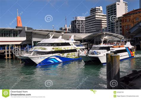 Ferry Boat New Zealand by Ferry Boats Leaving Auckland Wharf New Zealand Editorial