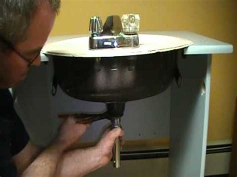 old plumber shows how to install a drain on a bathroom