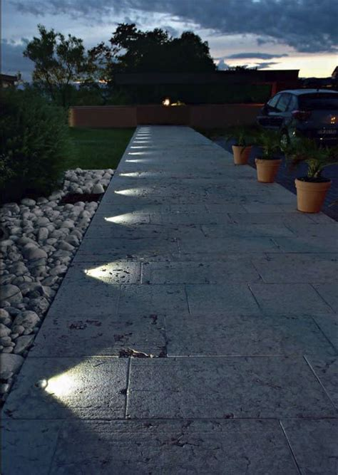 recessed in ground lighting suddenly turns this pathway
