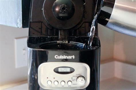 Pour the solution into the water chamber: How to Clean a Cuisinart Coffeemaker   Coffee maker, Coffee stain removal, Cleaning
