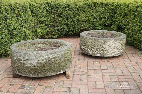 Large low round sandstone planters