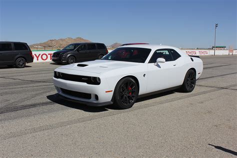 Charger Hellcat Or Challenger Hellcat by Charger And Challenger Hellcat On Track Front