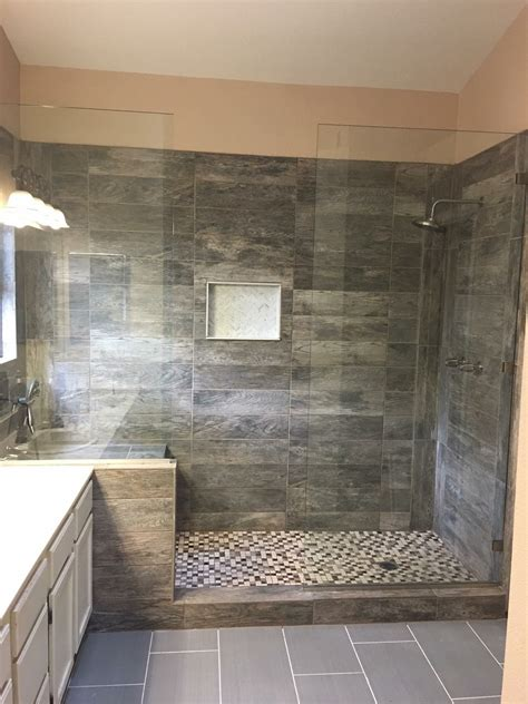 large tile shower  double shower heads  bench seat