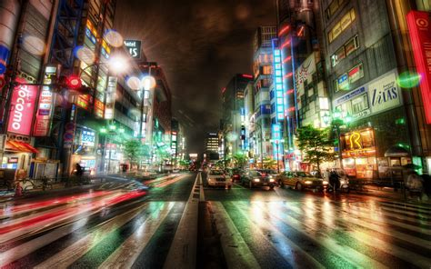 japan tokyo city night scene city lights flashing ads busy street buildings mobile