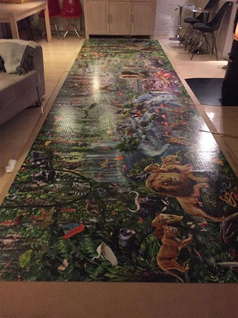 girl  finished  worlds largest jigsaw puzzle
