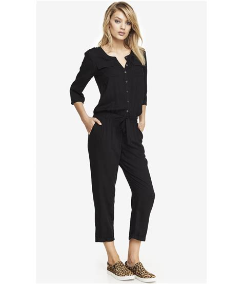 express jumpsuits express woven button front jumpsuit in black lyst