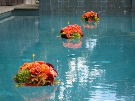 floating flowers  pool wedding   floating floral